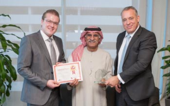 Mohammed A Al Khaja, Vice Chairman of The Emirates Airline Foundation receiving recognition from CFI.co