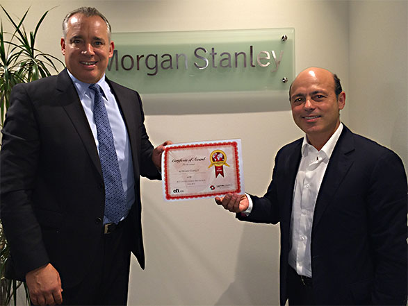 Sammy Kayello, Chairman and CEO of Morgan Stanley (MENA) receives an award from CFI.co