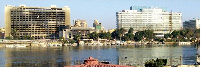 The old party headquarters (left) of ousted autocrat Hosni Mubarak, along the Nile River near Tahrir Square in Cairo. The buildings were looted and burned in January 2011 during the early stages of Egypt's revolution.