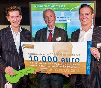 Floris Wolters (left) and his brother Roderick (right) of Solar Solutions Worldwide accept the Jan Terlouw Innovatieprijs (Innovation Award) 2014 from Mr Terlouw (centre), an acclaimed author, scientist, and former minister of economic affairs and member of parliament. The award is given out annually by the kiEMT Foundation of the Netherlands to the most innovative entrepreneur in the field of sustainable energy. Photo: John Voermans