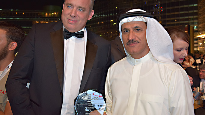 "Minister of Economy, H.E Sultan bin Saeed Al Mansouri accepting an award from CFI.co for ""Best FDI Destination"". Photo copyright CFI.co"