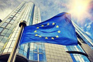 EU flag waving in front of European Parliament building. Brussels, Belgium