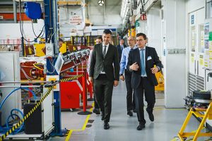 Elekta CEO, Richard Hausmann (right) tours the manufacturing site in Crawley, UK